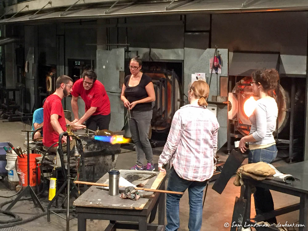 Artists work in the hot shop
